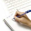 Woman hand writing with pen in notebook — Stock Photo #56922205