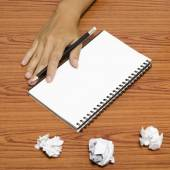 Hand writing on notebook with crumpled paper — Stock Photo