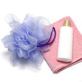 Bath puff liquid soap and towel — Stock Photo