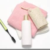 Towel loofah liquid soap and toothbrush — Stock Photo