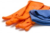 Blue rag with orange cleaning glove — Stock Photo