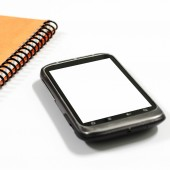 Smartphone with  note book — Stockfoto