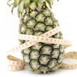 Pineapple with measuring tape — Stock Photo #62367065