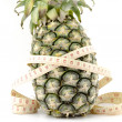 Pineapple with measuring tape — Stock Photo #62510967