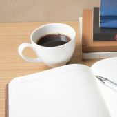 Open book with coffee cup — Stock Photo