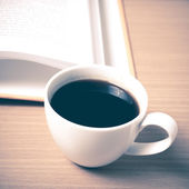Open book with coffee cup — Stock fotografie