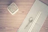 Kitchen towel with spoon on wood background — Stock Photo