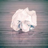 Crumpled paper on table — Stock Photo