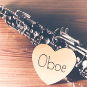 Oboe on wood background — Stock Photo
