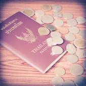 Thai passport with coins — Stock Photo