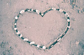 Heart on sand at the beach — Stock Photo