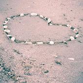Heart on sand at the beach — Stock Photo