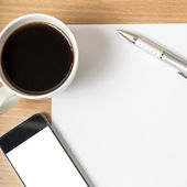 Coffee cup and smartphone — Stock Photo