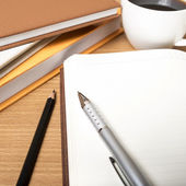 Open notebook with coffee cup — Stock Photo