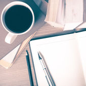 Open notebook and coffee cup — Stock Photo