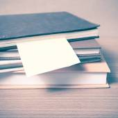 Stack of books with sticky note — Stock Photo