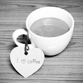 Coffee cup with heart tag write I love coffee word black and whi — Stock Photo