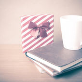 Book with gift box vintage style — Stock Photo