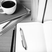 Open notebook with book and coffee cup  black and white color to — Stock Photo