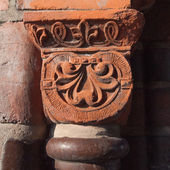 Old column head in red sandstone — Stock Photo