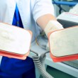 Plates defibrillator in the hands of the doctor is ready to save — Stock Photo #56479647