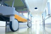Stretcher (mobile bed) in a hospital corridor waiting for the pa — Stock Photo