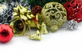Christmas background with a golden ornament and decorations — Stock Photo
