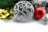 Christmas background with a silver ornament and decorations — Stock Photo