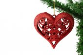 Christmas background with a red heart ornament  — Stock Photo