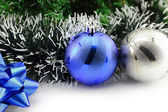 Christmas background with a blue ornament and decorations — Stock Photo