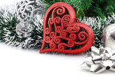 Christmas background with a red heart ornament and decorations — Stock Photo