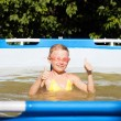 Happy girl in the pool — Stock Photo #52349825