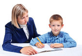 Mother teaches the child — Stock Photo