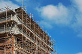 Scaffolding on old building under renovation — Stock Photo