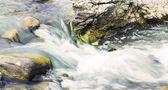 Water flowing over rocks — Foto Stock