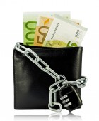Black wallet with money tied with chain and padlock on white background — Stock Photo