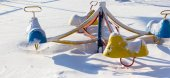Frozen scenes of carousel in snow — Stock Photo