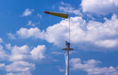 Airsock with signal mast on blue sky — Stock Photo
