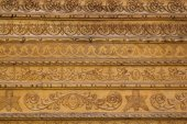 Close up ornamental wood  carvings on the wall of monasteries in — Stock Photo