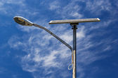 Solar powered street light with blue sky and clouds — Stock Photo