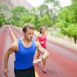 Couple running concentrated on road — Stock Photo #52885503