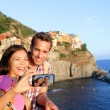 Couple taking picture in Cinque Terre — Stock Photo #52886163