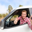 Driver showing car keys and thumb up — Stock Photo #52886325