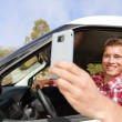 Driver taking photo with smartphone — Stock Photo #52886409