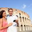 Couple in Rome by Colosseum using smartphone — Stock Photo #52886631