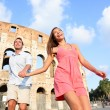 Couple in Rome by Colosseum running — Stock Photo #52886681
