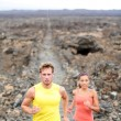 Runners jogging outdoors — Stockfoto