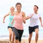 Friends running on beach — Stock Photo #52886785