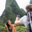 Couple taking photos on Hawaii — Stock Photo #52886871