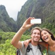 Couple taking selfie during hiking on Hawaii — Stock Photo